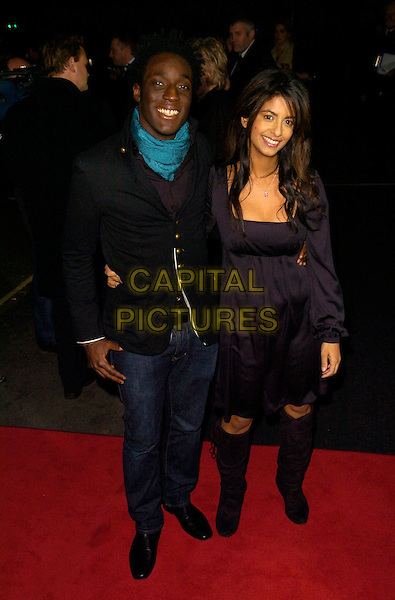 ANDY AKINWOLERE & KONNIE HUQ.The 12th British Academy of Film and TV Childrens Awards at the Hilton, Park Lane, London, England..November 25th 2007 .BAFTA BAFTA's full length black dress knee high boots jeans denim jacket scarf blue .CAP/CAN.©Can Nguyen/Capital Pictures