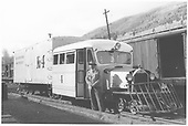 RGS Goose #4 at Rico depot platform with photographer Elmore Frederick posing.<br /> RGS  Rico, CO  Taken by Collins, Robert F. - 10/2/1946
