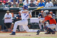 Florida Gators outfielder Harrison Bader (8) follows through on his swing against the Virginia Cavaliers in Game 11 of the NCAA College World Series on June 19, 2015 at TD Ameritrade Park in Omaha, Nebraska. The Gators defeated Virginia 10-5. (Andrew Woolley/Four Seam Images)
