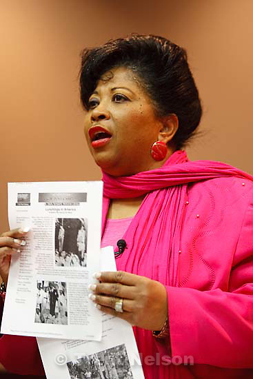 Salt Lake City - Branch President Jeanetta Williams holds up images of lynchings as the Salt Lake branch of the NAACP called for the resignation of Utah Senator Chris Buttars, after he failed to show up their board meeting to address his recent controversial comments, Tuesday, February 19, 2008. at left.