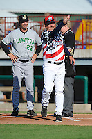 Bill Richardson #24 , manager of the Burlington Bees and Scott Steinmann #22 of the Clinton LumberKings meet at home plate prior to the game at Community Field  on July 3, 2014 in Burlington, Iowa. The LumberKings defeated the Bees 6-5..   (Dennis Hubbard/Four Seam Images)