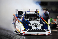 Sept. 17, 2010; Concord, NC, USA; NHRA funny car driver Tim Wilkerson does a burnout during qualifying for the O'Reilly Auto Parts NHRA Nationals at zMax Dragway. Mandatory Credit: Mark J. Rebilas/