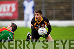 David Mannix Austin Stacks in action against Fergal Griffin Mid Kerry in the Kerry Senior County Football Final at Fitzgerald Stadium on Sunday.