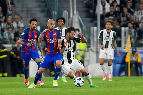 April 11th 2017, Juventus Stadium, Turin, Italy; UEFA Champions league football quarterfinal, leg 1, Juventus versus Barcelona; Javier Mascherano and Miralem Pjanic fight for the ball