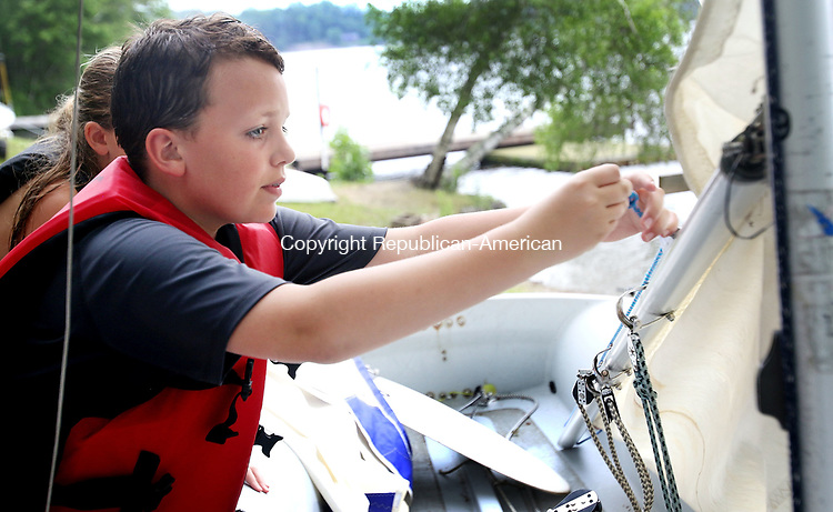 MIDDLEBURY CT. 19 June 2017-061917SV03-Luke Cenatiempo, 11, of Woodbury secures a sail during sail class at Quassapaug Sailing Center in Middlebury Monday.<br /> Steven Valenti Republican-American