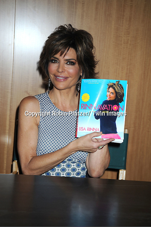 "Lisa Rinna signs her new book "" The Big, Fun, Sexy Sex Book"" at Barnes & Noble on May 3, 2012 in New York City. Ian Kerner was her co writer."