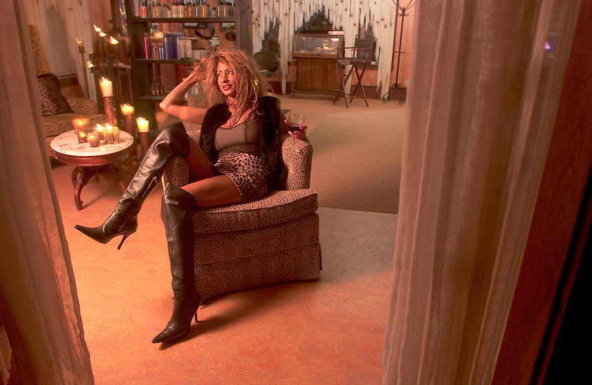 Cheyenne Stone, owner of the Blue Room salon in Jackson, Wyo., poses in her waiting area.