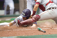 TCU's Taylor Featherston is tagged out against Florida State in Game 1 of the NCAA Division One Men's College World Series on Saturday June 19th, 2010 at Johnny Rosenblatt Stadium in Omaha, Nebraska.  (Photo by Andrew Woolley / Four Seam Images)