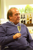 Julio Viola, president and owner with a glass of sparkling wine Bodega Del Fin Del Mundo - The End of the World - Neuquen, Patagonia, Argentina, South America
