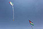 A kite laden with a molotov cocktail being flown by Palestinian youths over the border with Israel before cutting the string across the fence, during clashes with Israeli security forces at tents protest where Palestinians demand the right to return to their homeland, at the Israel-Gaza border, in Khan Younis in the southern Gaza Strip on May 11, 2018. Photo by Ashraf Amra