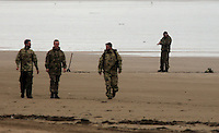 "Pictured: Bomb experts prepare the device for a detonation at Cefn Sidan beach, near Pembrey west Wales, UK. Saturday 21 May 2016<br /> Re: A suspected bomb washed up on a Welsh beach has been detonated a bomb disposal unit after a walker came across it at Cefn Sidan beach, west Wales.<br /> After the discovery, the beach, aprt of Pembrey Country Park in Carmarthenshire , was cordoned off.<br /> The device was subsequently detonated.<br /> A spokesman for HM Coastguard Swansea said: ""The bomb disposal team is on the scene dealing with the object and it has just been detonated.""<br /> ""We will now be clearing up the debris and making sure the beach is clean and safe."""