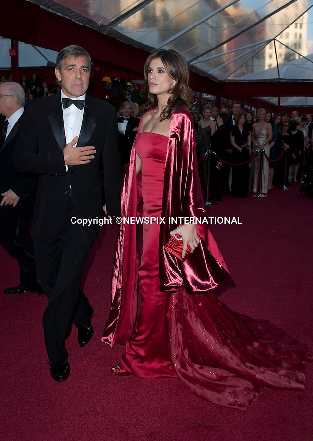 "OSCARS 2010 RED CARPET ARRIVALS_GEORGE CLOONEY AND GIRLFRIEND ELISABETTA CANALIS.The 82nd Academy Awards  arrivals took place under a transparent tent to keep the red carpet dry from the pending rain_ Kodak Theatre, Hollywood, Los Angeles_07/03/2009.Mandatory Photo Credit: ©Dias/Newspix International..**ALL FEES PAYABLE TO: ""NEWSPIX INTERNATIONAL""**..PHOTO CREDIT MANDATORY!!: NEWSPIX INTERNATIONAL(Failure to credit will incur a surcharge of 100% of reproduction fees)..IMMEDIATE CONFIRMATION OF USAGE REQUIRED:.Newspix International, 31 Chinnery Hill, Bishop's Stortford, ENGLAND CM23 3PS.Tel:+441279 324672  ; Fax: +441279656877.Mobile:  0777568 1153.e-mail: info@newspixinternational.co.uk"