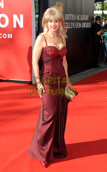 SALLY FARMILOE .Arrivals at the British Academy Television Awards 2009, Royal Festival Hall, London, England..April 26th 2009.TV Baftas bafta's full length red dress bustier long maxi gold clutch bag beaded sparkly .CAP/FIN.©Steve Finn/Capital Pictures