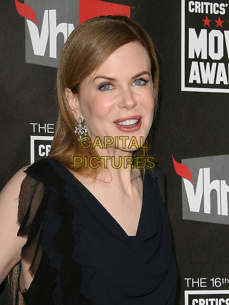 NICOLE KIDMAN .at The16th Annual Critics' Choice Movie Awards held at The Hollywood Palladium in Hollywood, California, USA, January 14th, 2011..portrait headshot smiling black navy blue dangly earrings silver mouth open funny .CAP/RKE/DVS.©DVS/RockinExposures/Capital Pictures.