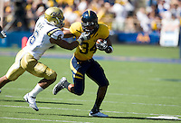 September 4, 2010:  Shane Vereen of California tries to break a tackle by Tony Dye of UCLA for a short gain during a game against UCLA at Memorial Stadium in Berkeley, California.   California defeated UCLA 35-7
