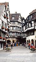 Colmar: Houses, narrow street. Timbered buildings.