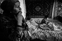 An elderly woman living alone with her granddaughter in exclusion zone near Vetka city. Belorussia