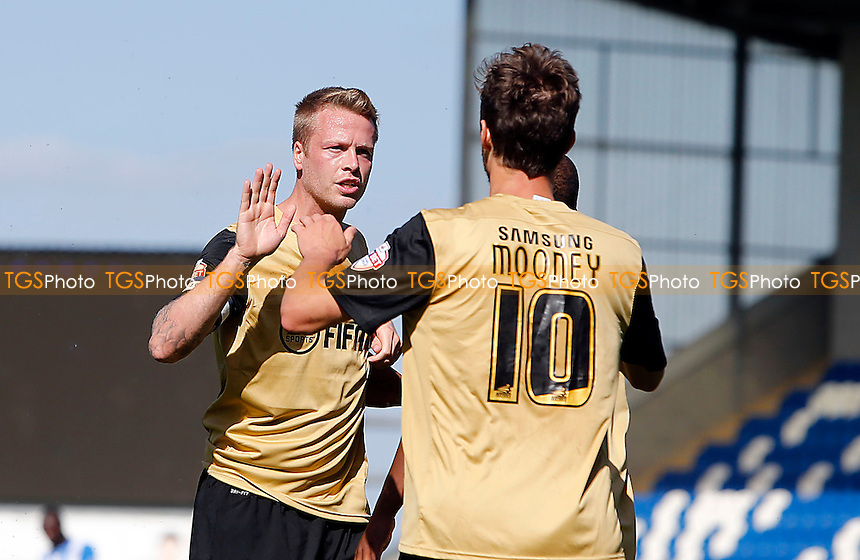 Capt Nathan Clarke celebrates O's goalscorer David Mooney<br /> - Colchester United vs Leyton Orient  - SkyBet League One Football Match at the Weston Homes Community Stadium,Colchester,Essex - 31/08/13 - MANDATORY CREDIT:Simon O&quot;Connor/TGSPHOTO - Self billing applies where appropriate - 0845 094 6026 - contact@tgsphoto.co.uk - NO UNPAID USE