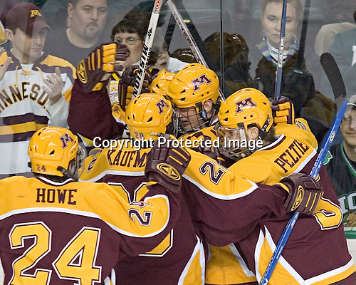 Celebrating Bostrom's goal - Mike Howe, Evan Kaufmann, Justin Bostrom, PJ Atherton, Derek Peltier - The University of Minnesota Golden Gophers defeated the University of North Dakota Fighting Sioux 4-3 on Saturday, December 10, 2005 completing a weekend sweep of the Fighting Sioux at the Ralph Engelstad Arena in Grand Forks, North Dakota.