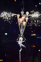 PICTURE BY ALEX BROADWAY /SWPIX.COM - 2012 London Paralympic Games - Day Eleven - Closing Ceremony, Olympic Stadium, Olympic Park, London, England - 09/09/12 - Acrobats perform during the closing ceremony.