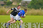 ohn Sheehan of Laune Ranger's gets away from Ardfert's chasing Jonathan Best in the division 1 game at Ardfert on Sunday..   Copyright Kerry's Eye 2008