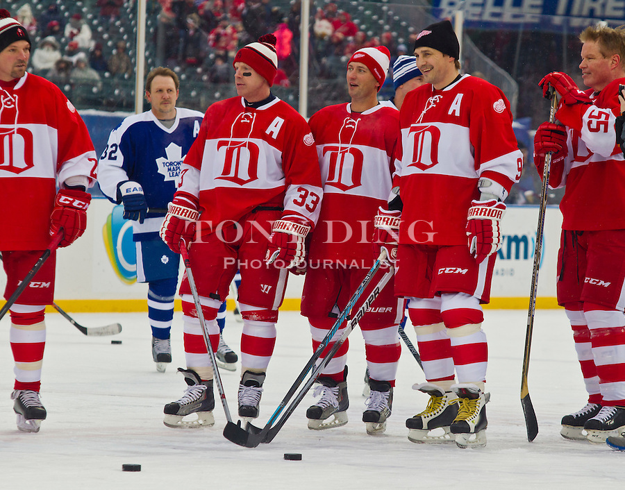 31 December 2013: Former Detroit Red Wings forward Kris Draper (33), defenseman Brian Rafalski, center, and forward Sergei Fedorov (91) stand around on the ice during warmups before the Toronto Maple Leafs v Detroit Red Wings Alumni Showdown hockey game, at Comerica Park, in Detroit, MI.