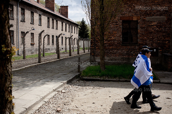 OSWIECIM, POLAND, APRIL 24, 2017:<br /> Jewish youths are walking  at the Auschwitz concentration camp museum with Israeli flags before start of the &quot;March of The Living&quot; an annual march between two camps of the Auschwitz concentration camp.<br /> (Photo by Piotr Malecki / Napo Images)<br /> ###<br /> OSWIECIM, 24/04/2017:<br /> Marsz Zywych w Oswiecimiu.<br /> Fot: Piotr Malecki<br /> <br /> ###ZDJECIE MOZE BYC UZYTE W KONTEKSCIE NIEOBRAZAJACYM OSOB PRZEDSTAWIONYCH NA FOTOGRAFII###