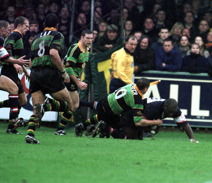 Photo. Richard Lane. .Northampton v Gloucester. 31/10/98. Steve Ojomoh is brought down by Ali Hepher.