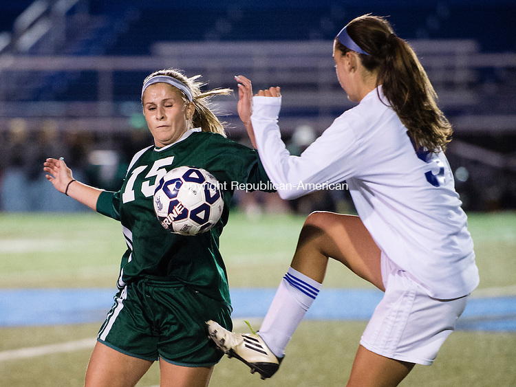 MIDDLETOWN, CT - 16 November 2015-111615EC07-- Holy Cross' Kylie Rice gets called for a handball during a confrontation with Old Lyme's Sam Lee in Middletown Monday night. Erin Covey Republican-American.