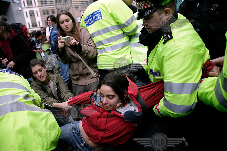 A young woman is arrested at the Climate Camp as thousands of protestors descended on the City of London ahead of the G20 summit of world leaders to express anger at climate change and the economic crisis, which many blame on the excesses of capitalism.