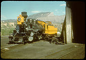 D&amp;RGW #473 K-28 in yellow and black paint scheme beside round house in Durango.<br /> D&amp;RGW  Durango, CO