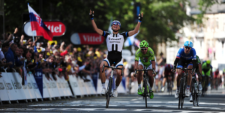 Picture by Simon Wilkinson/SWpix.com - 05/07/2014 - Cycling - Tour de France 2014 Grand Depart - Stage 1, Leeds to Harrogate - Yorkshire, England - Team Giant-Shimano's Marcel Kittel celebrates winning Stage 1 in Harrogate.