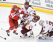 Marie-Philip Poulin (BU - 29), Ashley Motherwell (BC - 18), Danielle Welch (BC - 17), Molly Schaus (BC - 30) - The visiting Boston University Terriers defeated the Boston College Eagles 1-0 on Sunday, November 21, 2010, at Conte Forum in Chestnut Hill, Massachusetts.