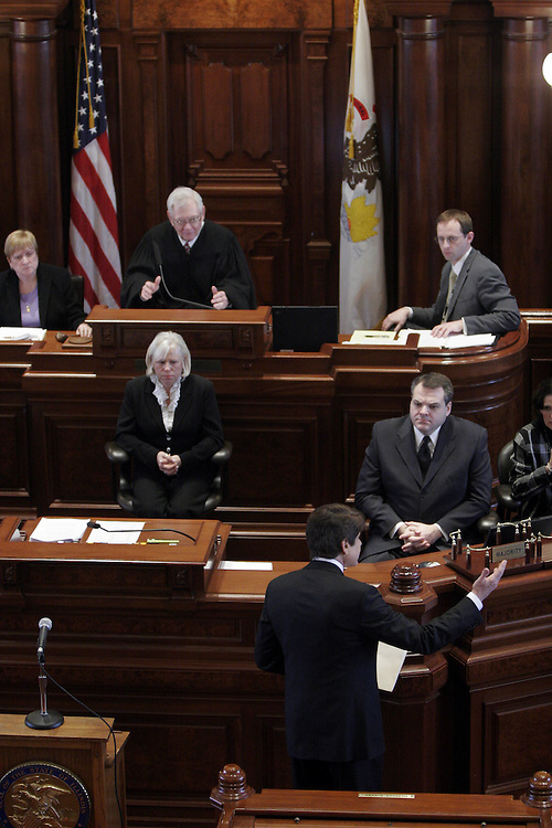 Declining Illinois Supreme Court Chief Justice Thomas Fitzgerald's offer to stay for the remainder of his impeachment trial, Gov. Rod Blagojevich exits the Senate chambers after making closing arguments on his own behalf at the Illinois State Capitol in Springfield, Ill., Thursday, January 29, 2009. Later that day the Illinois Senate voted 59-0 to remove him from office..Kristen Schmid Schurter