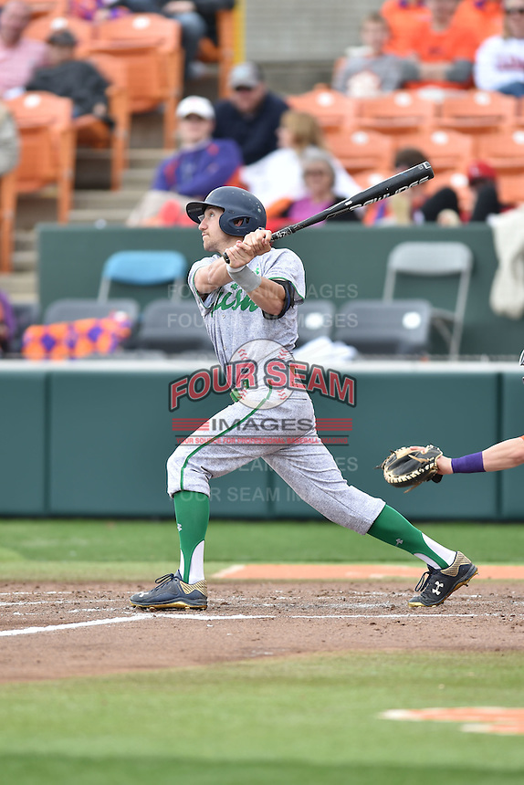 Notre Dame Fighting Irish center fielder Mac Hudgins (13) swings at a pitch during a game against the Clemson Tigers during game one of a double headers at Doug Kingsmore Stadium March 14, 2015 in Clemson, South Carolina. The Tigers defeated the Fighting Irish 6-1. (Tony Farlow/Four Seam Images)