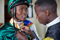 Jockey James Mahindi pinning the jersey of Waycliff Matee before The Kenya Derby.