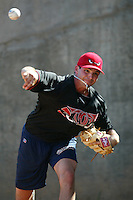 Justin Germano of the Lake Elsinore Storm throws before a game at The Diamond on June 29, 2003 in Lake Elsinore, California. (Larry Goren/Four Seam Images)