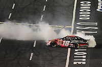 Oct. 15, 2009; Concord, NC, USA; NASCAR Nationwide Series driver Kyle Busch celebrates after winning the Dollar General 300 at Lowes Motor Speedway. Mandatory Credit: Mark J. Rebilas-