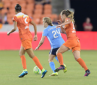 Houston, TX - Friday April 29, 2016: Kelly Conheeney (24) of Sky Blue FC takes the ball up the field with Cami Privett (23) of the Houston Dash in pursuit at BBVA Compass Stadium. The Houston Dash tied Sky Blue FC 0-0.