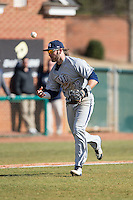 UNCG Spartans third baseman Colin Woody (22) can't handle a ground ball during the game against the High Point Panthers at Willard Stadium on February 14, 2015 in High Point, North Carolina.  The Panthers defeated the Spartans 12-2.  (Brian Westerholt/Four Seam Images)