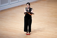 Stage Announcer Cindy Songwon Lee introduces a musician during Stage III at the 11th USA International Harp Competition at Indiana University in Bloomington, Indiana on Wednesday, July 10, 2019. (Photo by James Brosher)