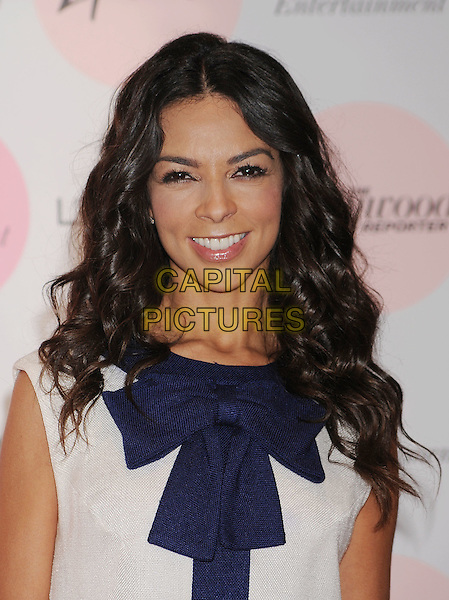 TERRI SEYMOUR .arriving at The Hollywood Reporter's Power 100: Women In Entertainment Breakfast at Beverly Hills Hotel in Beverly Hills, California, USA, .December 7th, 2010..portrait headshot cream beige navy bow stripe sleeveless smiling .CAP/ROT/TM.©TM/RothStock//Capital Pictures