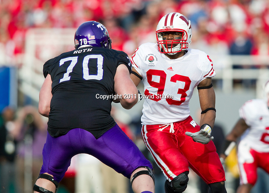 Wisconsin Badgers defensive lineman Louis Nzegwu (93) plays defense during the 2011 Rose Bowl NCAA Football game against the TCU Horned Frogs in Pasadena, California on January 1, 2011. TCU won 21-19. (Photo by David Stluka)