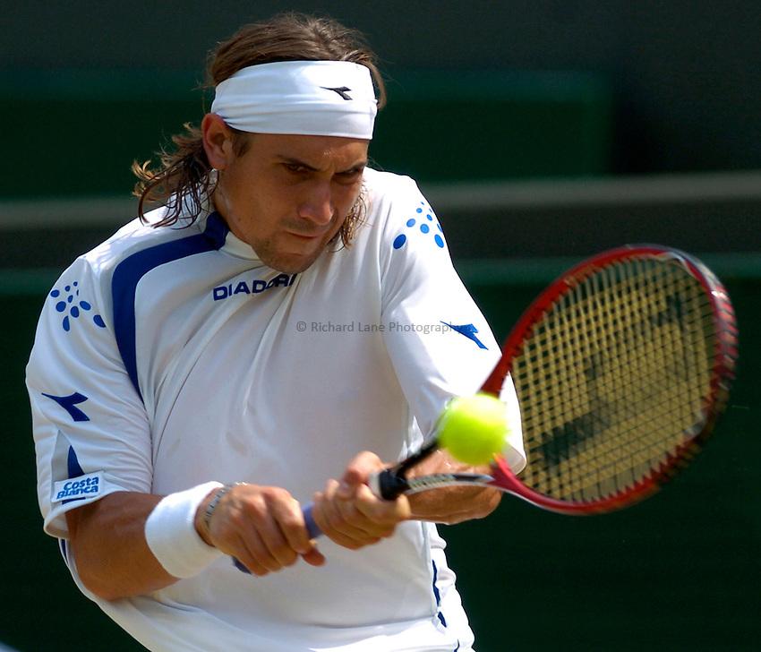 Photo: Richard Lane..Wimbledon Championships. 03/07/2006. .David Ferrer of Spain returns.