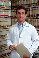 Portrait of medical professionalamong records.