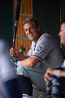 Northwest Arkansas Naturals third baseman Hunter Dozier (24) jokes with teammates in the dugout during a game against the Springfield Cardinals on April 26, 2016 at Hammons Field in Springfield, Missouri.  Northwest Arkansas defeated Springfield 5-2.  (Mike Janes/Four Seam Images)