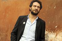 """Roma, 6 Aprile 2012.Photocall del film """"Diaz"""" .L'attore Claudio Santamaria"""