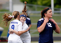 NWA Democrat-Gazette/DAVID GOTTSCHALK - 5/8/15 - Rogers Heritage High School's Olivia Allard (right) walks away from Rogers High School Lady Mounties Sienna Nealon (left) and Skylurr Patrick as they celebrate the first goal of the game Friday May 8, 2015 at Rogers High Smith Stadium.