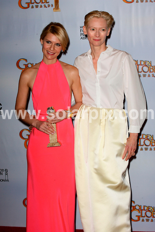 **ALL ROUND PICTURES FROM SOLARPIX.COM**                                             **SYNDICATION RIGHTS FOR UK, AUSTRALIA, DENMARK, PORTUGAL, S. AFRICA, SPAIN & DUBAI (U.A.E) & ASIA (EXCLUDING JAPAN) ONLY**                                                                                  68th Annual Golden Globe Awards. Press Room Beverly Hilton Hotel, Beverly Hills, CA, USA                                                            .This pic:   Claire Danes and Tilda Swinton                                                                      .JOB REF:     12675   PHZ/Charlotte       DATE: 17.01.11                                                           **MUST CREDIT SOLARPIX.COM OR DOUBLE FEE WILL BE CHARGED**                                                                      **MUST AGREE FEE BEFORE ONLINE USAGE**                               **CALL US ON: +34 952 811 768 or LOW RATE FROM UK 0844 617 7637**