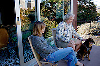 Los Angeles, California, November 14, 2009 - Diane and Ernie Wolfe sit out on their balcony with their dog Malaika. The Wolfe's own the Ernie Wolfe Gallery and are the most reknowned African at dealers in the country. ..CREDIT: Daryl Peveto/LUCEO for The Wall Street Journal.Homefront - Ernie Wolfe #1348.
